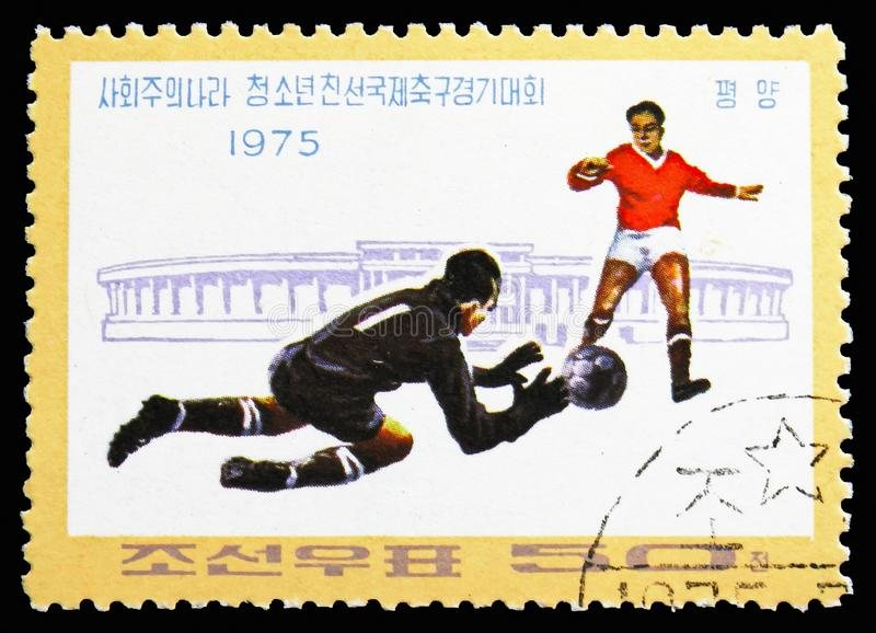 Players and Stadium, Socialist Countries ' Junior Friendship Football Tournament serie, circa 1975 stock photo