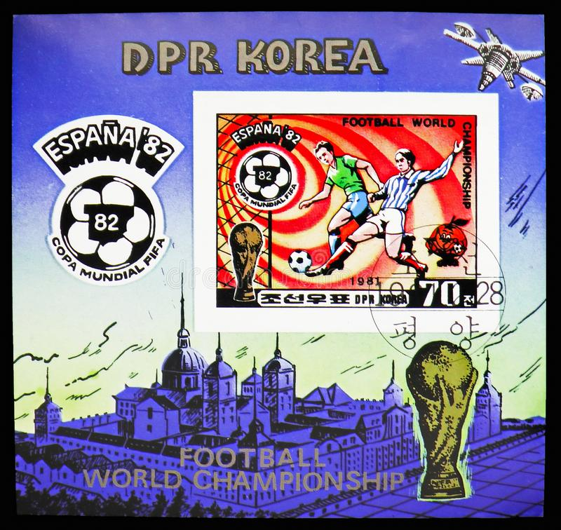 Sliding tackle, Football World Cup 1982, Spain (IV) serie, circa 1981. MOSCOW, RUSSIA - OCTOBER 21, 2018: A stamp printed in Korea shows Sliding tackle, Football stock photography
