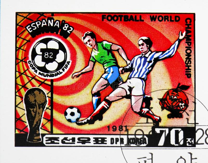 Sliding tackle, Football World Cup 1982, Spain (IV) serie, circa 1981. MOSCOW, RUSSIA - OCTOBER 21, 2018: A stamp printed in Korea shows Sliding tackle, Football stock photo