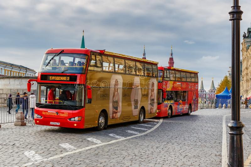 Moscow, Russia - October 08, 2019: Two bright red double-decker tourist buses parked near Red square. Red square is a famous. Touristic landmark in Moscow royalty free stock photo