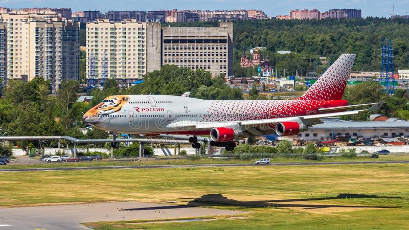 Moscow,Russia-07/02/2018:The passenger plane lands at Vnukovo International Airport VKO in Moscow. Boeing 747 registration number EI-XLD, Rossiya airlines lands stock images