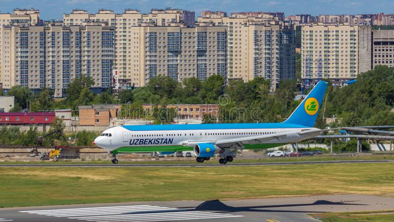 Moscow,Russia-07/02/2018:The passenger plane lands at Vnukovo International Airport VKO in Moscow. Boeing 767 registration number UK67003, Uzbekistan Airways royalty free stock photo