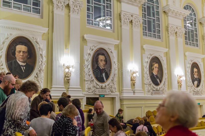 Portraits of classical composers on the wall of Moscow Conservatory. Interior of Moscow Conservatory. 2019.01.19, Moscow, Russia. Portraits of classical royalty free stock photo