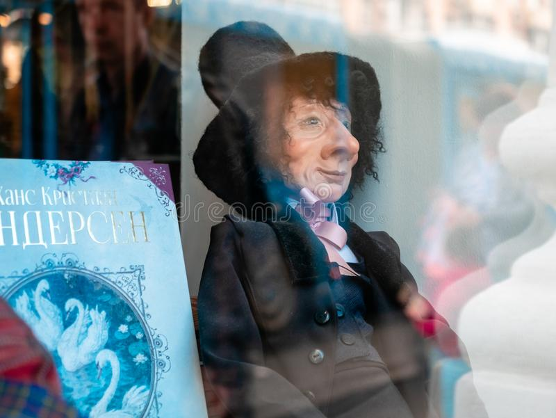 Dolls depicting a fairy tale hero with a book by Hans Christian Andersen in a window of a Moscow Puppet Theater. royalty free stock photography
