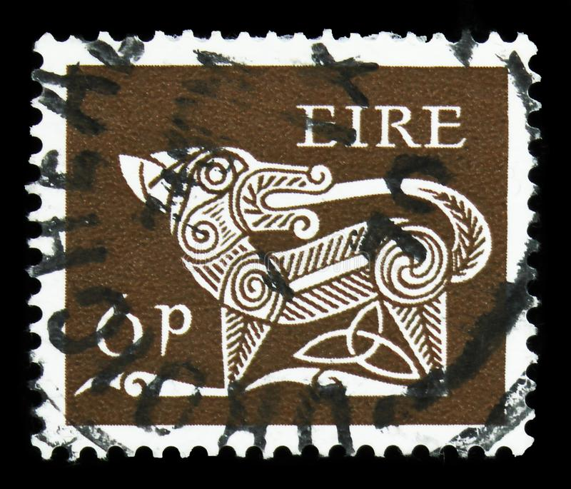 Stylised Dog, 7th Century Brooch, Early Irish Art 1968-70 serie, circa 1969. MOSCOW, RUSSIA - SEPTEMBER 22, 2019: Postage stamp printed in Ireland shows Stylised royalty free stock images