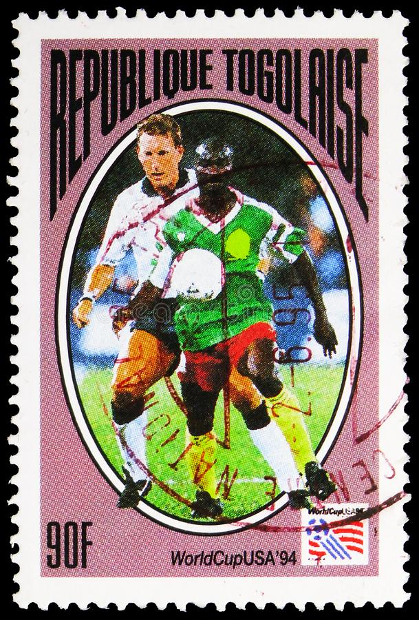 Postage stamp printed in Togo shows Game Scene, 90 CFA - West African CFA franc, Football Wold Cup, USA 1994 serie, circa 1994 royalty free stock photography