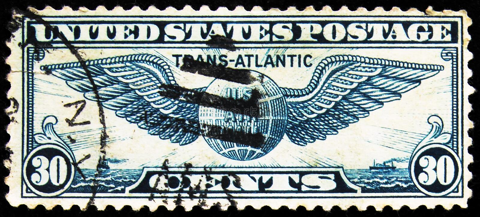 Postage stamp printed in United States shows Winged Globe, Transatlantic Issue serie, circa 1939. MOSCOW, RUSSIA - SEPTEMBER 27, 2019: Postage stamp printed in stock image