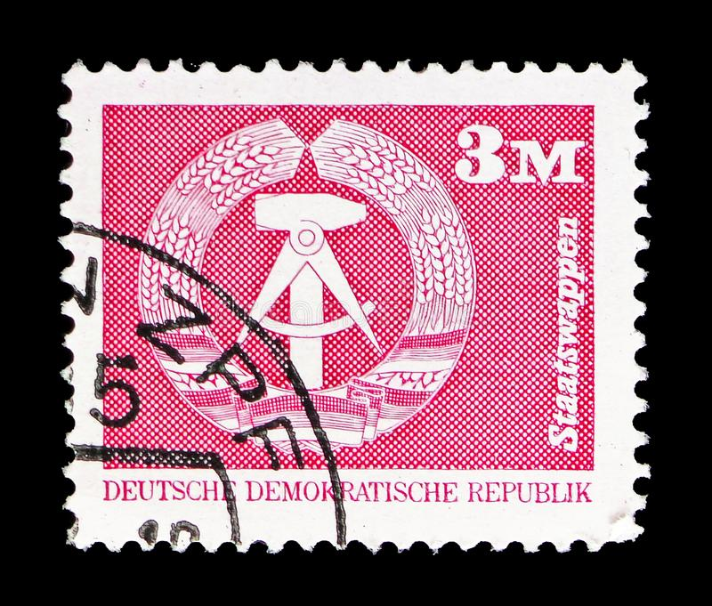 National Coat of Arms, Construction in the GDR, small format serie, circa 1981. MOSCOW, RUSSIA - SEPTEMBER 15, 2018: A stamp printed in DDR (Germany) shows stock photo