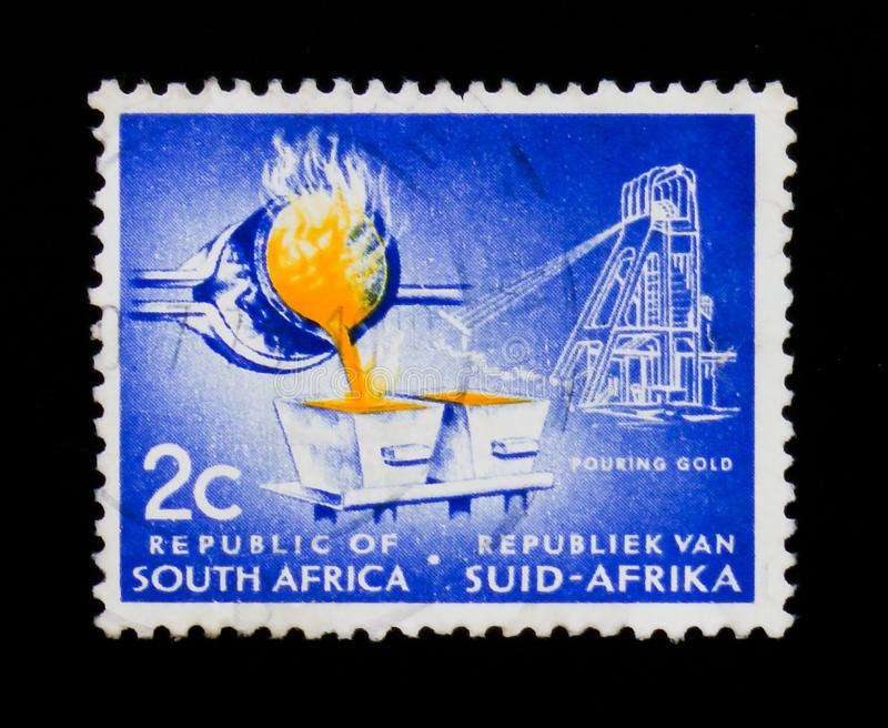 MOSCOW, RUSSIA - SEPTEMBER 3, 2017: A stamp printed in South Africa shows Gold pouring, Definitive Issue - Decimal Issue serie, c. Irca 1961 royalty free stock photos