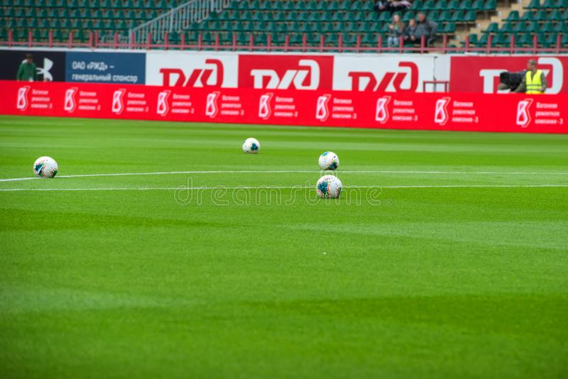 Soccer balls on the green grass of the stadium stock photography
