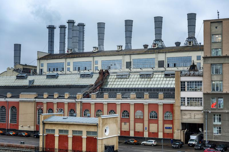 Moscow, Russia, 11/05/2019: View of an industrial building with smoking pipes on the promenade in the city center royalty free stock photo