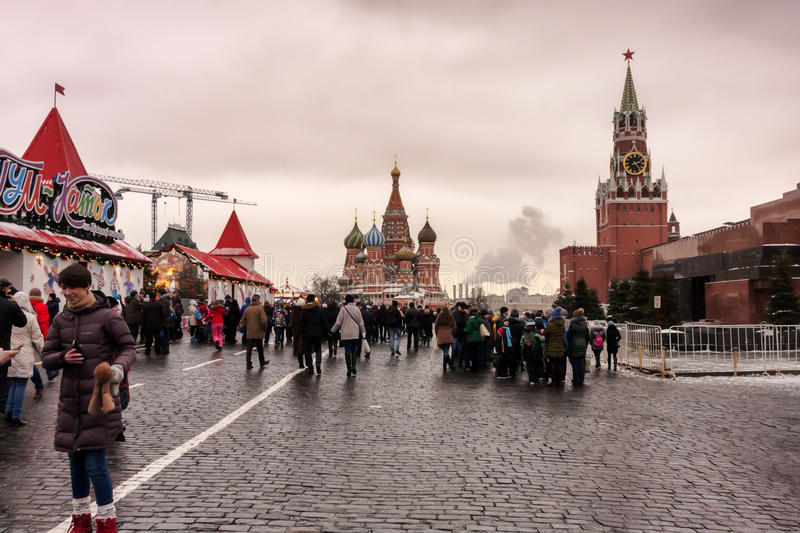 Moscow, Russian Federation - January 21, 2017 : View from Red Square, on the right the Lenin s Mausoleum and Spasskaya tower. Forward the St. Basil s Cathedral royalty free stock photo