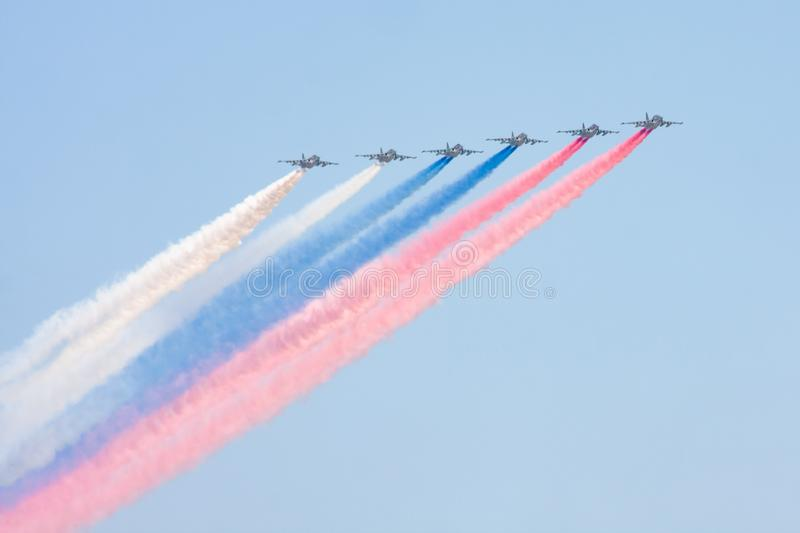 Moscow, Russian Federation, May 07 2019. Training flight of aircraft producing smoke in the colors of the flag of Russia before stock image