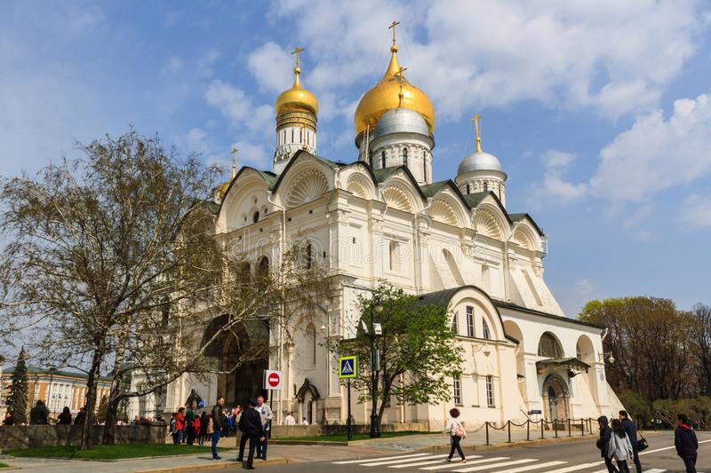 Tourists visit The Cathedral of the Dormition is the largest church in the Moscow Kremlin, Russia. royalty free stock photos