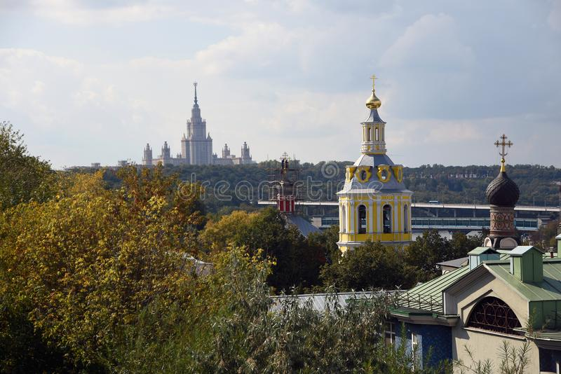 Moscow State University main building and Saint Andrews monastery. Color photo. stock photography
