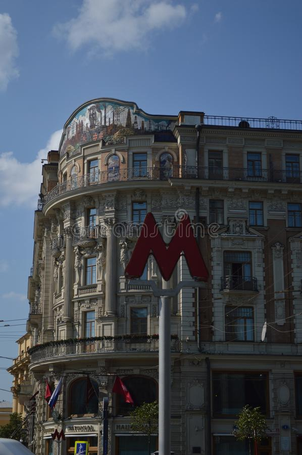 Moscow street with Metro sign  in a summer day stock image
