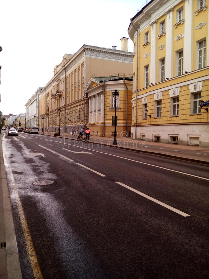 Moscow street road a beautiful yellow building stock photo