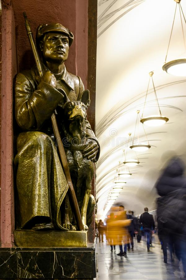 Moscow subway station Revolution Square. Bronze Sculpture of soviet soldier with dog royalty free stock photo