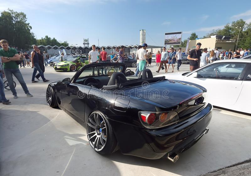 Moscow. Summer 2018. Black Honda S2000 tuned on stance style. On air suspension, with polish wide wheels stock images