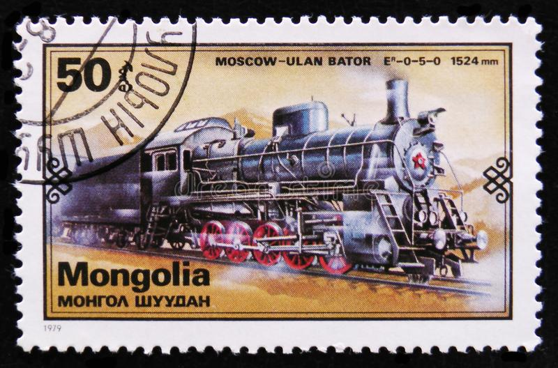 Moscow - Ulan Bator train, Retro trains serie, circa 1979. MOSCOW, RUSSIA - APRIL 2, 2017: A post stamp printed in Mongolia shows Moscow - Ulan Bator train stock photos