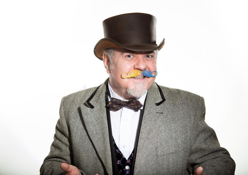 Mustache is an adult male artist in a business suit and a cylinder hat. MOSCOWED MAN IN A CYLINDER HAT in a business sui. Cheerful storyteller leading stock images