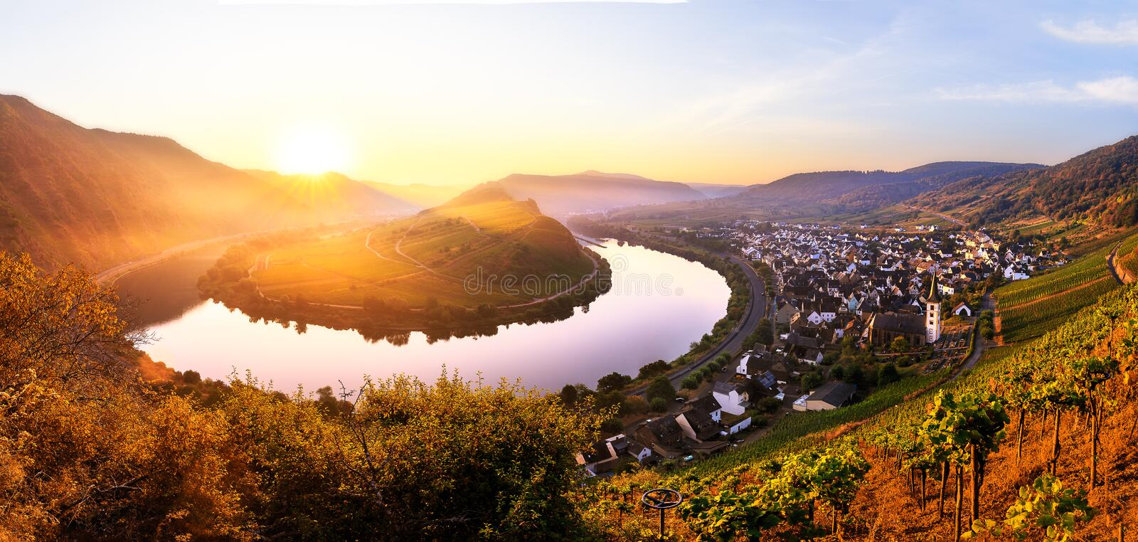 Moselle river bend. Sunrise at the moselle river bend over the village Bremm stock image