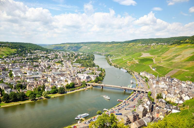 Moselle Valley Germany: View from Landshut Castle to the old town Bernkastel-Kues with vineyards and river Mosel in summer. Germany Europe royalty free stock image