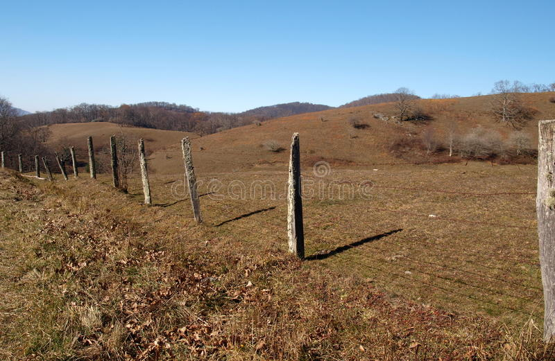 Moses Cone Memorial Park. A hiking trail to Trout Lake follows a line of fence posts at Moses Cone Memorial Park, near Blowing Rock, North Carolina royalty free stock photos