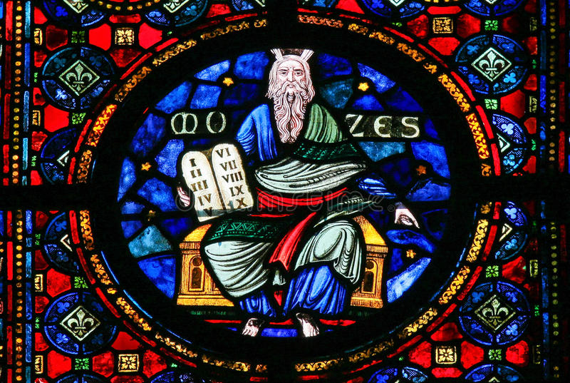 Moses and the Stone Tablets - Stained Glass. Stained Glass window of Moses and the Stone Tablets with the Ten Commandments in the Church of Dinant, Belgium stock image
