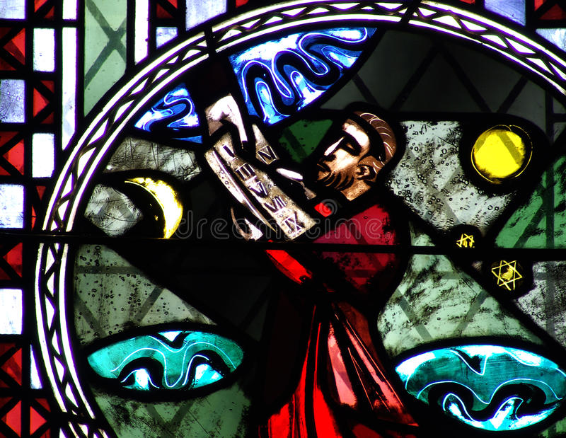 Moses and the Ten Commandments in stained glass. A photo of Moses and the Ten Commandments in stained glass stock images