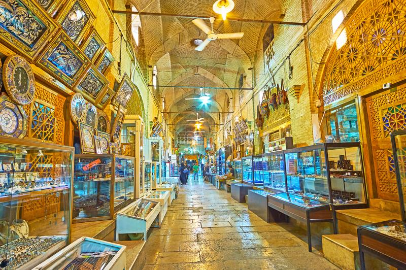 Moshir Bazaar in Shiraz, Iran. SHIRAZ, IRAN - OCTOBER 12, 2017: The long jewelry alley of Moshir Bazaar, decorated with brick domes and carved wooden doors of stock image