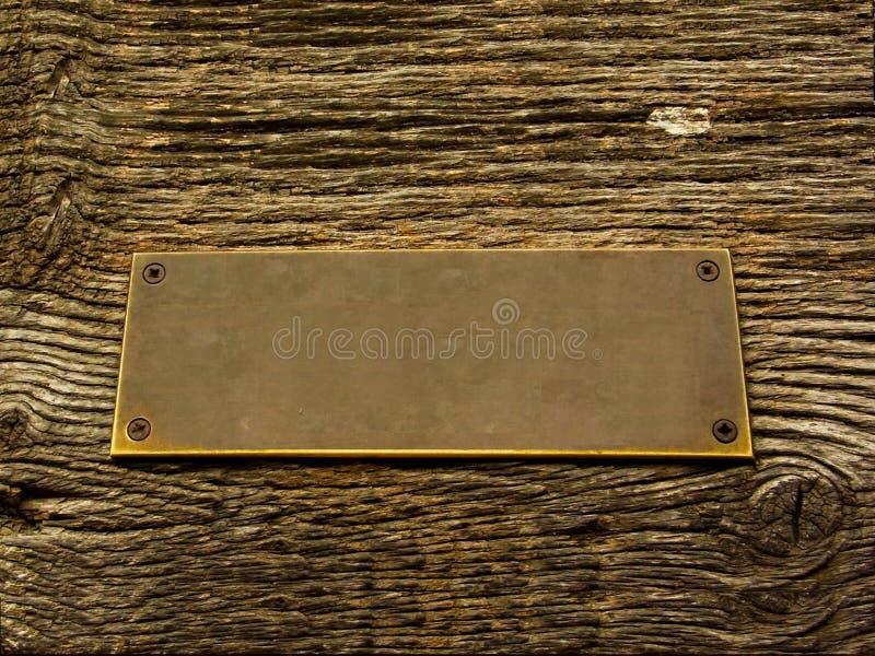 Mosiądz na drewno znaku obrazy stock