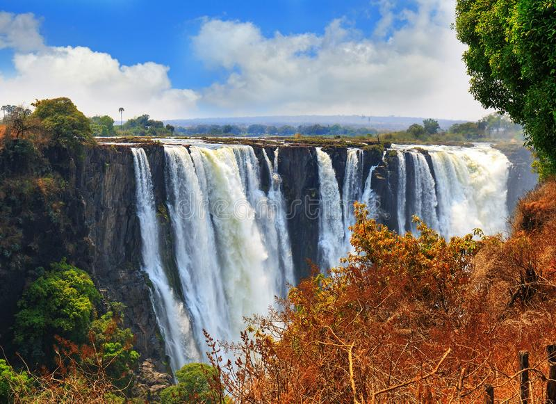 Mosi-o-tunya Victoria Falls with a nice blue cloudy sky in Zimbabwe, Southern Africa. Victoria Falls taken from the Zimbabwe side overlooking Zambia, with a blue royalty free stock photo
