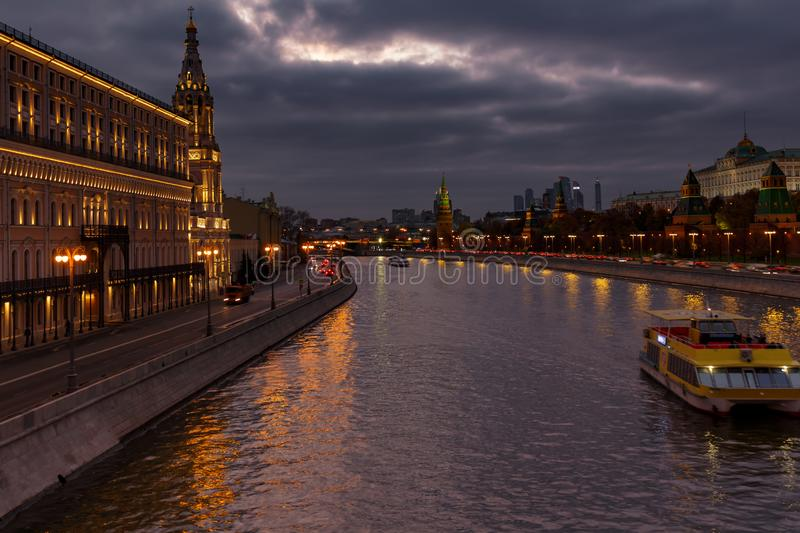 Moskva river embankments on a background of dramatic cloudy sky in evening. Moscow landscape stock image