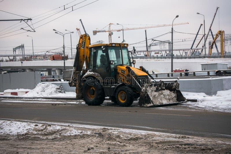 MOSKWA, ROSJA, GRUDZIEŃ, 27 2018: Rozlewny model ogólnoludzki backhoe ładowacz JCB Firma Wielki Brytania zdjęcie stock