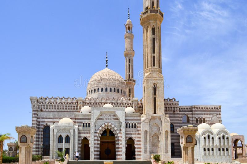 Moslem Islamic mosque of white brick for the collection of Muslims for general prayer, a liturgical architectural structure with a stock photo