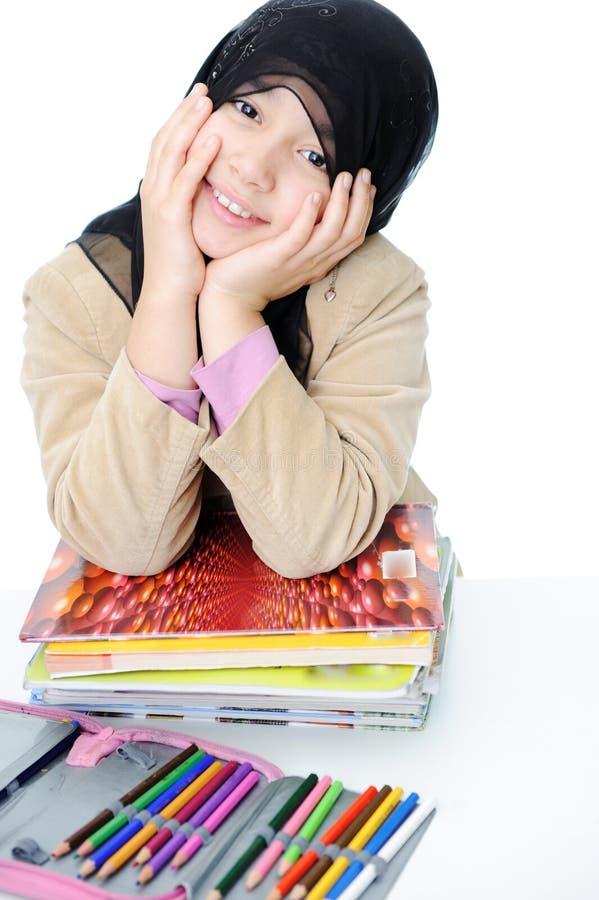 Moslim schoolmeisje stock afbeeldingen