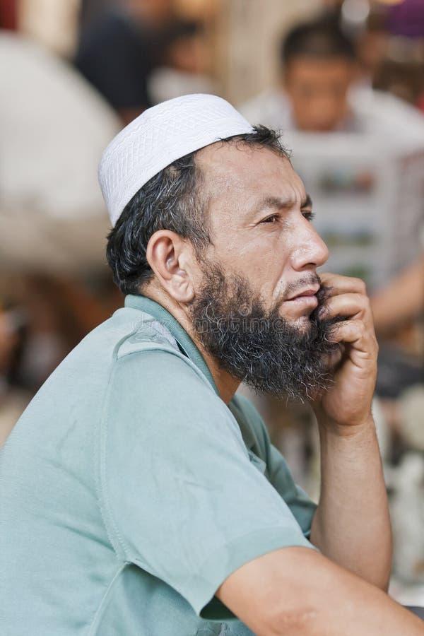 Moslimverkoper op een vlooienmarkt, Peking, China royalty-vrije stock foto's