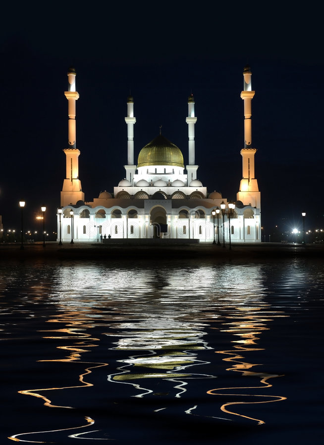 Mosque ashore bay at night royalty free stock photography