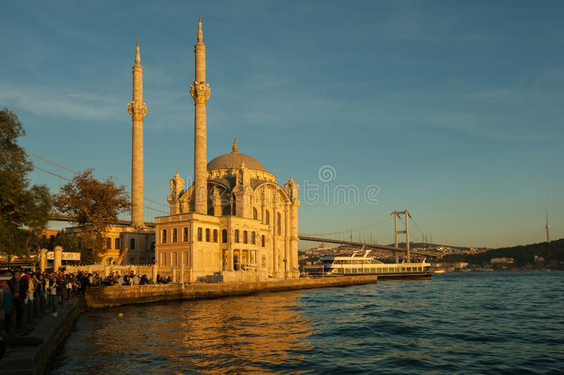 Mosque and bridge at sunset stock images