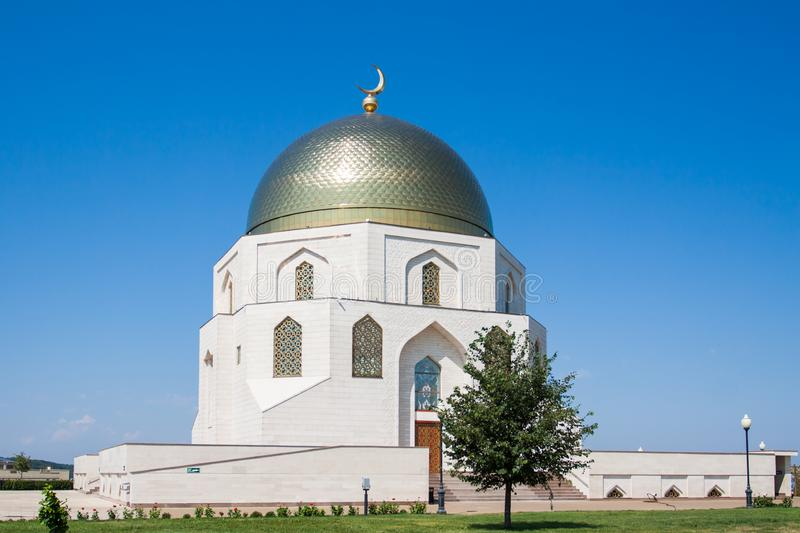 The mosque building is made of white stone. stock photo