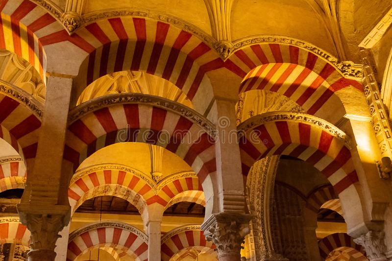 The Mosque Catedral of Cordoba. The orange and yellow colored arches of the Mezquita Catedral de Cordoba in Andalusia in Spain royalty free stock photo