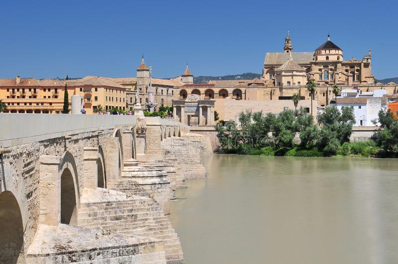 Mosque Cathedral La Mezquita and Roman Bridge on Guadalquivir river in Cordoba, Spain, Andalusia region. Mosque Cathedral La Mezquita and Roman Bridge on royalty free stock image