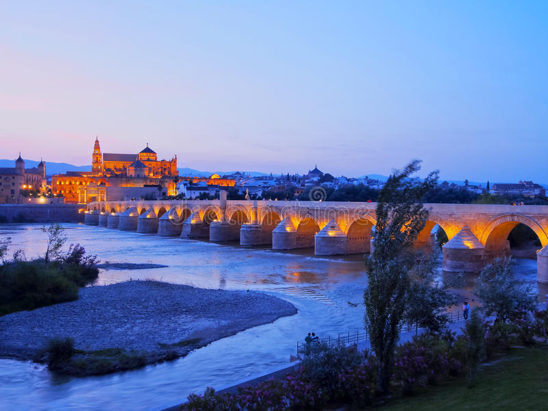 Mosque-Cathedral and the Roman Bridge in Cordoba royalty free stock photos