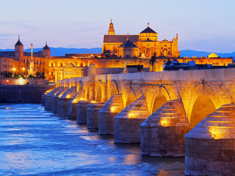 Mosque-Cathedral and the Roman Bridge in Cordoba. Night view of Mezquita-Catedral and Puente Romano - Mosque-Cathedral and the Roman Bridge in Cordoba, Andalusia royalty free stock photo