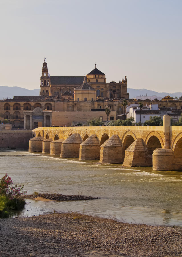 Mosque-Cathedral and the Roman Bridge in Cordoba, Spain royalty free stock images
