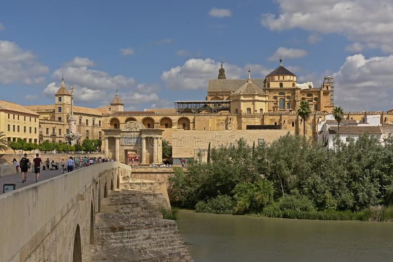Mosque cathedral and roman bridge over Guadalquivir river in  Cordoba. Mosque cathedral or Mezquita of Cordoba, along old roman arch bridge over guadalquivir royalty free stock photography
