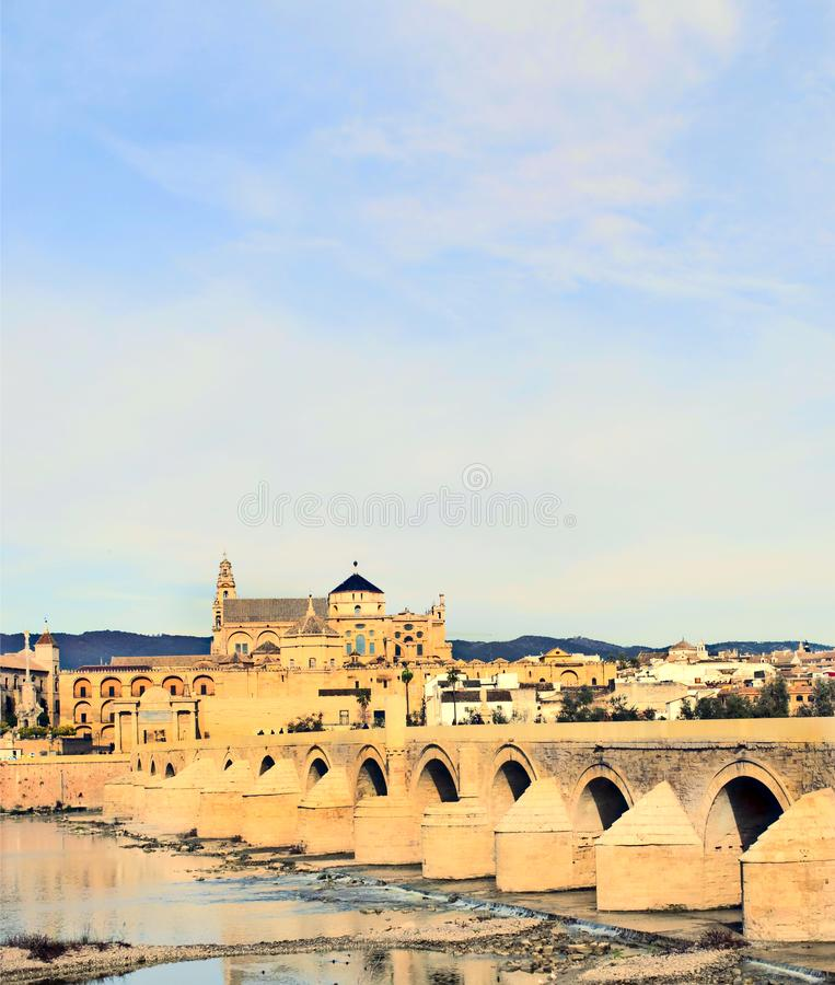 Mosque of Cordoba. Cathedral next to the mosque of Cordoba in the river Guadalquivir in a cloudy day stock photography
