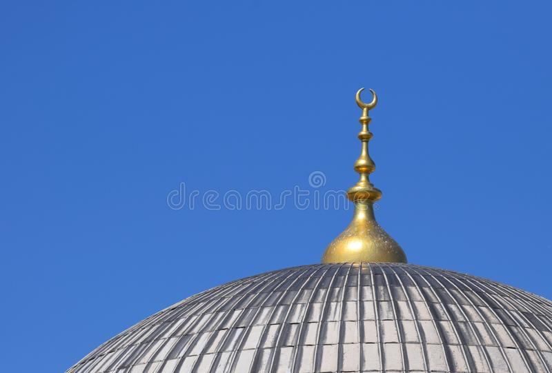 Mosque Dome with a Golden Crescent Moon stock photo