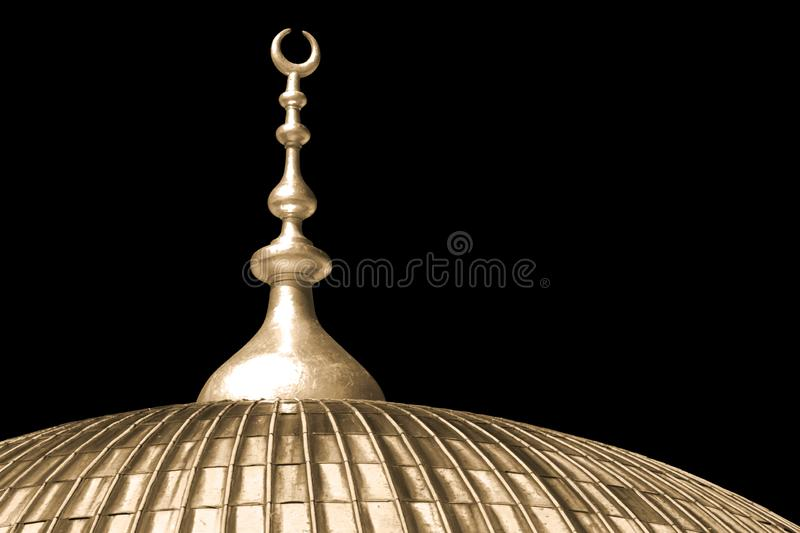 Mosque Dome with a Golden Crescent Moon. Solid black background. The top of a mosque dome with traditional islamic crescent moon symbol finished in gold on a royalty free stock image